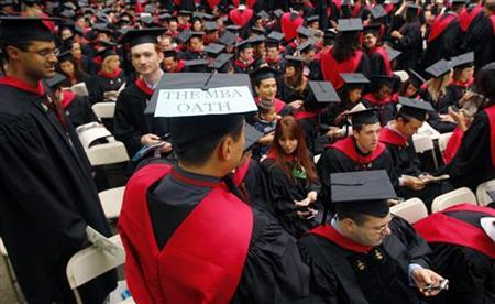 Harvard Business School student Danial Moon wears a sign reading ''The MBA Oath'' before Harvard University's 358th Commencement Exercises in Cambridge, Massachusetts in this June 4, 2009 file photo. REUTERS/Brian Snyder