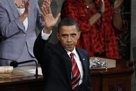 President Barack Obama waves goodbye at the end of his first State of the Union address to a joint session of Congress on Capitol Hill in Washington, January 27, 2010. REUTERS/Jim Young