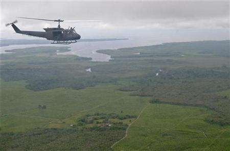 A military helicopter flies over Colombia's Narino province in a file photo. REUTERS/Jaime Saldarriaga