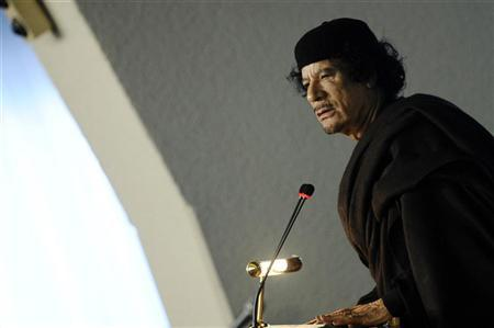 Libya's leader Muammar Gaddafi speaks at the U.N. Food and Agriculture Organisation (FAO) food security summit in Rome November 16, 2009. REUTERS/Filippo Monteforte/POOL