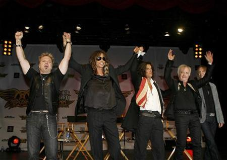 (L-R) Aerosmith's Joey Kramer, Steven Tyler, Joe Perry, Brad Whitford, and Tom Hamilton attend a press conference for the new video game ''Guitar Hero: Aerosmith'' in New York, June 27, 2008. REUTERS/Lucas Jackson
