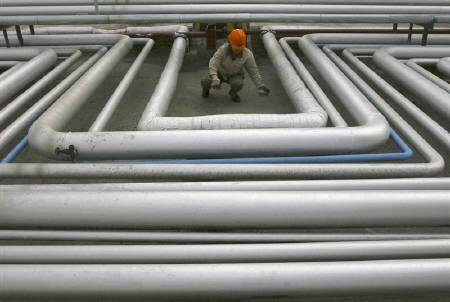 A worker checks pipelines at an oil refinery in Lanzhou in this April 2007 file photo. China will soon be burning oil and gas piped in through Myanmar, but putting some of its energy security in the hands of a pariah state beset by international sanctions and civil strife could be a risky gamble. REUTERS/Stringer