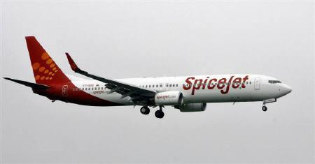 A SpiceJet aircraft prepares for landing at the airport in Mumbai in this July 15, 2008 file photo. REUTERS/Punit Paranjpe/Files