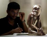 "<p>Art student Kumar Raj examines a sculpture at an exhibition of Malaysia's aboriginal wood sculptures entitled ""Asli"" in Kuala Lumpur, April 19. REUTERS/Bazuki Muhammad</p>"