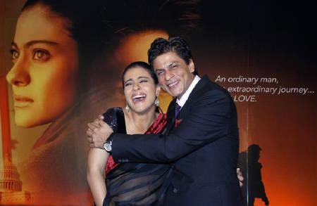 Bollywood actors Shah Rukh Khan (R) and Kajol smile during a news conference for their forthcoming movie ''My Name is Khan'' in Mumbai in this December 16, 2009 file photo. REUTERS/Manav Manglani/Files