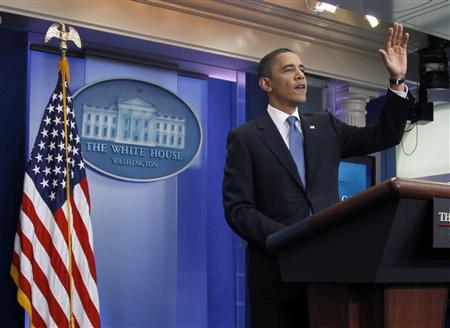 U.S. President Barack Obama waves as he leaves an impromptu news conference in the Brady Press Briefing Room of the White House in Washington, February 9, 2010. REUTERS/Jason Reed