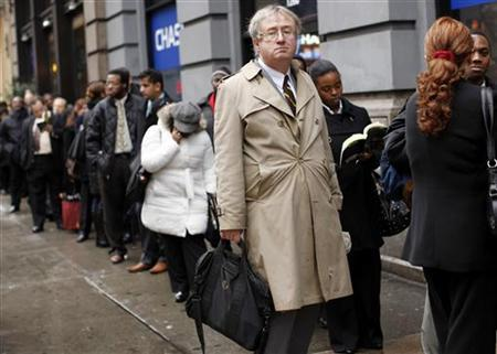A man waits in line to enter the NYCHires Job Fair in New York, December 9, 2009. REUTERS/Shannon Stapleton