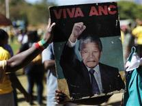 <p>African National Congress supporters hold up a poster to celebrate the 20th anniversary of Nelson Mandela's release at Drakenstein Correctional Centre (formerly Victor Verster Prison), near Paarl in Western Cape province February 11, 2010. REUTERS/Finbarr O'Reilly</p>