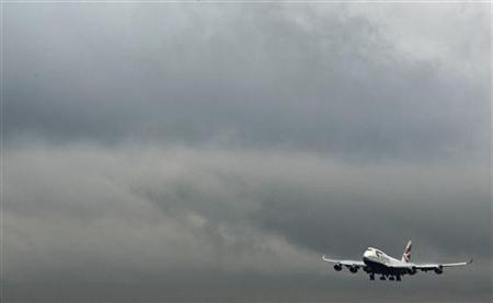 A British Airways jet comes in to land at Heathrow Airport west of London November 13, 2009. REUTERS/Luke MacGregor