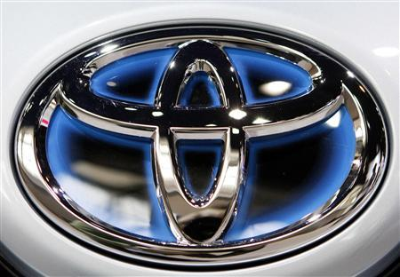 A Toyota logo is seen on the front of a plug-in Prius at the Chicago Auto Show February 10, 2010. REUTERS/John Gress