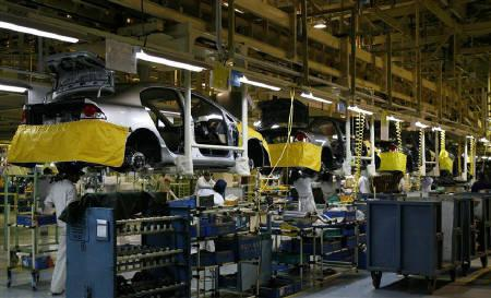 Workers Assemble Cars At A Plant Of Honda Siel India Ltd On The Outskirts