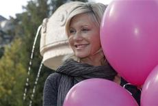 "<p>Australian singer and actress Olivia Newton-John poses to promote the ""Pink Ribbon"" breast cancer campaign in Vienna October 5, 2009. REUTERS/Heinz-Peter Bader</p>"