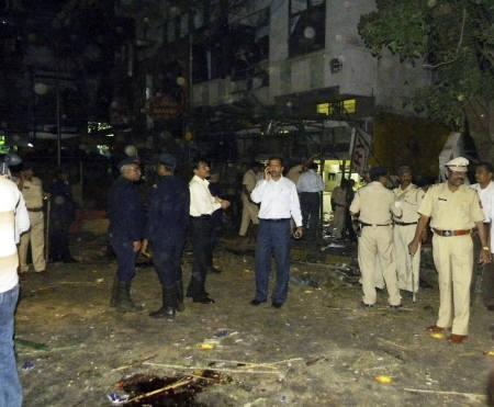 Police gather at the site of a bomb blast in Pune February 13, 2010. At least eight people were killed in a suspected bomb blast at a restaurant popular with foreign tourists in Pune, police said on Saturday. REUTERS/Rituparna Bhowmik