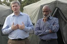<p>Canada's Prime Minister Stephan Harper (L) speaks next to Haiti's President Rene Preval (R) during a news conference at Port-au-Prince February 15, 2010. REUTERS/St. Felis Evens</p>