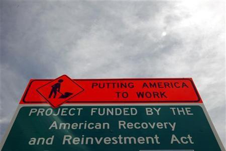 A sign announces a section of road work funded by the American Recovery and Reinvestment Act U.S. economic stimulus plan in the Denver area September 10, 2009. REUTERS/Rick Wilking