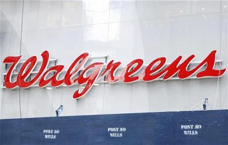 A Walgreens sign can be seen above Times Square in New York, September 29, 2008. REUTERS/Lucas Jackson