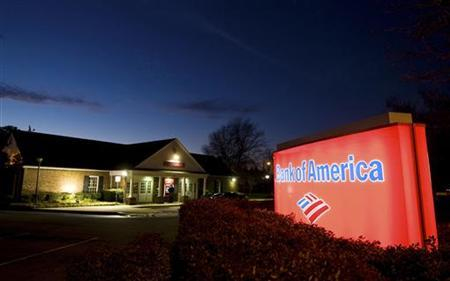 A Bank of America customer uses an ATM in Charlotte, North Carolina January 19, 2010. REUTERS/Chris Keane