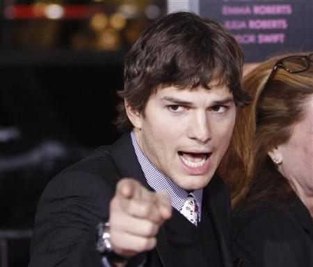 Cast member Ashton Kutcher gestures at the premiere of ''Valentine's Day'' at the Grauman's Chinese theatre in Hollywood, California February 8, 2010. REUTERS/Mario Anzuoni