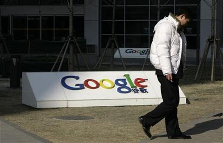 A man walks past Google China headquarters in Beijing January 26, 2010. REUTERS/Jason Lee