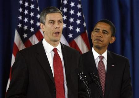 President-elect Barack Obama (R) listens to Chicago Public Schools Chief Arne Duncan during a news conference at the Dodge Renaissance Academy in Chicago in this December 16, 2008 file photo. REUTERS/Jeff Haynes
