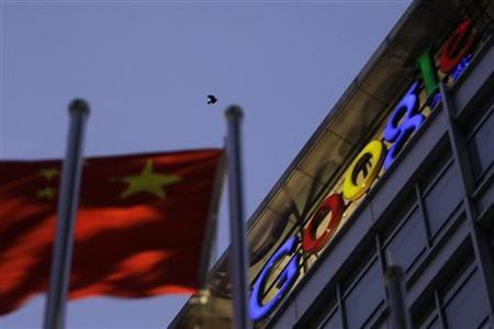 A bird flies over Google China headquarters building next to a Chinese national flag in Beijing in this January 14, 2010 file photo. REUTERS/Jason Lee