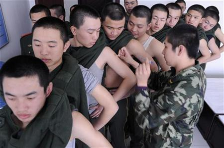 Recruits of the paramilitary police receive injections of the H1N1 vaccine at a military base in Taiyuan, Shanxi province February 2, 2010. REUTERS/Stringer