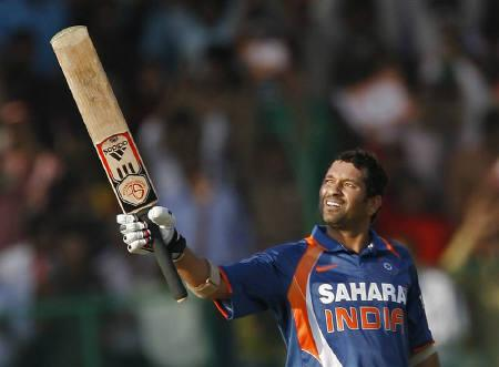 India's Sachin Tendulkar raises his bat to celebrate his century during the second one-day international cricket match between  India and South Africa in Gwalior February 24, 2010.  REUTERS/Punit Paranjpe