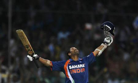 Sachin Tendulkar celebrates his double century during the second one-day international cricket match between India and South Africa in Gwalior February 24, 2010.  REUTERS/Punit Paranjpe