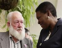<p>Former child migrant, 74-year-old Michael Snell (L) of Gloucestershire, talks with Britain's High Commissioner to Australia, Baroness Valerie Amos, at an apology reception at the British Consul General's residence in Sydney February 25, 2010. British Prime Minister Gordon Brown apologised on Wednesday for past British policies of shipping thousands of poor children abroad, mostly without their parents' knowledge, to former colonies where many suffered abuse. REUTERS/Tim Wimborne</p>