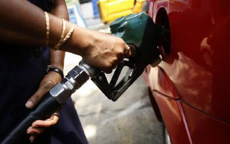 An employee fills a customer's tank at a petrol pump entirely run by woman in Kolkata May 24, 2008. The government on Friday raised prices of diesel and petrol, two television channels said. REUTERS/Jayanta Shaw/Files