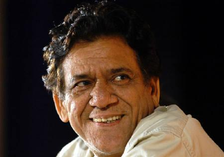 A file photo of actor Om Puri as he smiles during his felicitation ceremony organised in Bombay August 15, 2004. REUTERS/ Shyam Sunder/Files