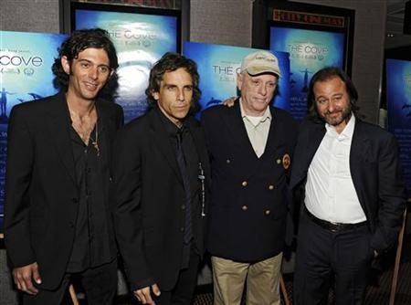 Videographer Lincoln O'Barry, producer Ben Stiller, actor Richard O'Barry and producer Fisher Stevens (L to R) attend an advance screening of ''The Cove'', a film about dolphins and a secret cove in Japan, in New York July 15, 2009. REUTERS/Ray Stubblebine