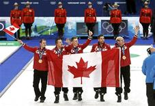 <p>Canada's skip Kevin Martin (R-L), John Morris, Marc Kennedy, Ben Hebert and alternate Adam Enright celebrate with their gold medals after defeating Norway in their men's gold medal curling game at the Vancouver 2010 Winter Olympics February 27, 2010. REUTERS/Andy Clark</p>