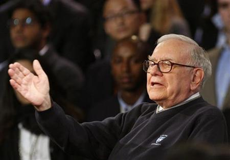 Billionaire investor Warren Buffett speaks as he and Microsoft Corporation founder Bill Gates appear together for a town hall style meeting with business students broadcast by financial television network CNBC at Columbia University in New York, November 12, 2009. REUTERS/Mike Segar