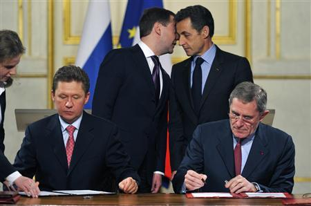 France's President Nicolas Sarkozy (2nd R) speaks with his Russian counterpart Dmitri Medvedev (2nd L) as GDF-SUEZ CEO Gerard Mestrallet (R) and GAZPROM CEO Alex Miller (L) sign an agreement before a news conference at the Elysee Palace in Paris March 1, 2010. REUTERS/Philippe Wojazer