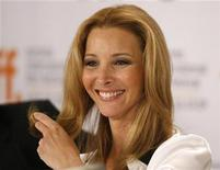 "<p>Actress Lisa Kudrow smiles during the news conference for the film ""Love And Other Impossible Pursuits"" during the 34th Toronto International Film Festival in Toronto September 16, 2009 file photo. REUTERS/Mike Cassese</p>"