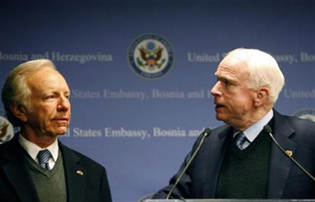 Senators John McCain (R) and Joe Lieberman talk during a news conference in Sarajevo in this February 5, 2010 file photo. REUTERS/Danilo Krstanovic