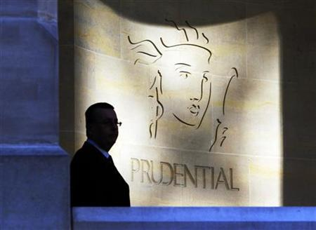 A security guard is silhouetted in front a Prudential office in London March 1, 2010. REUTERS/Luke MacGregor