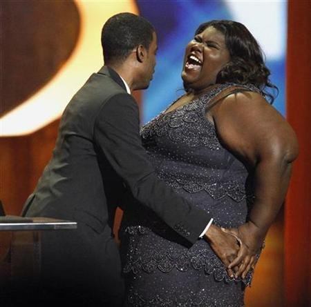 Actress Gabourey Sidibe is congratulated by actor Chris Rock after being announced winner of the award for Outstanding Actress in a Motion Picture at the 41st Annual NAACP Image Awards at the Shrine auditorium in Los Angeles February 26, 2010. REUTERS/Mario Anzuoni