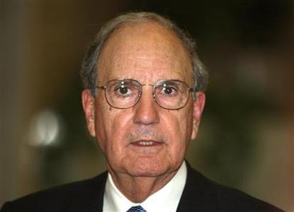 George Mitchell, the U.S. special envoy to the Middle East, reads a statement after meeting with Syria's President Bashar al-Assad in Damascus January 20, 2010. REUTERS/ Khaled al-Hariri