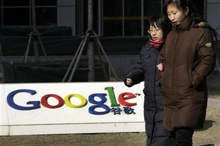 Pedestrians walk past Google China headquarters in Beijing January 26, 2010 file photo. REUTERS/Jason Lee