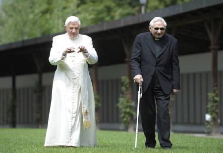 Pope Benedict XVI strolls in a garden with his brother Bishop Georg Ratzinger during his annual holiday in Bressanone, northern Italy July 31, 2008. REUTERS/Osservatore Romano