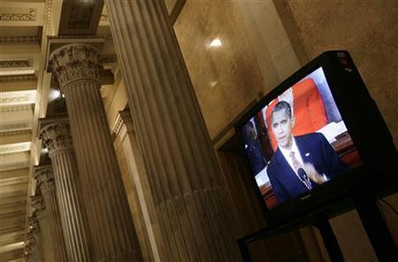 President Barack Obama is seen on television on U.S. Capitol during his speech about healthcare reform before a joint session of congress on Capitol Hill in Washington, September 9, 2009. REUTERS/Yuri Gripas