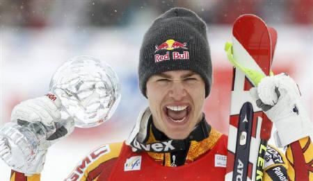 Erik Guay of Canada  celebrates with the Super-G World Cup trophy after winning the men's Super-G race at the Alpine Skiin World Cup finals in Garmisch-Partenkirchen March 11, 2010. REUTERS/Michaela Rehle