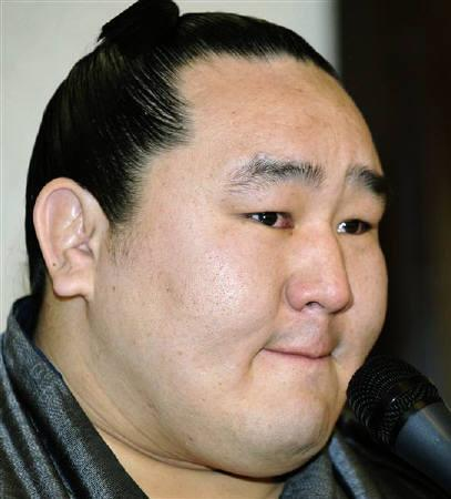 Mongolian-born sumo grand champion Asashoryu reacts during a news conference in Tokyo February 4, 2010. REUTERS/Kyodo/Files