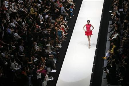 A model presents a creation in Kuala Lumpur November 5, 2009. REUTERS/Bazuki Muhammad