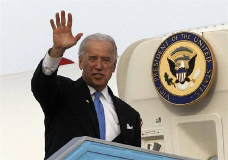 U.S. Vice President Joe Biden waves before boarding a plane at Ben Gurion International airport near Tel Aviv March 11, 2010. REUTERS/Ronen Zvulun