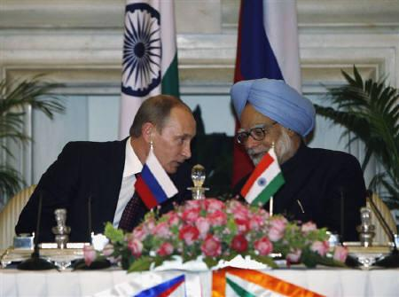 India's Prime Minister Manmohan Singh (R) speaks with Russia's Prime Minister Vladimir Putin during a joint news conference in New Delhi March 12, 2010. REUTERS/B Mathur
