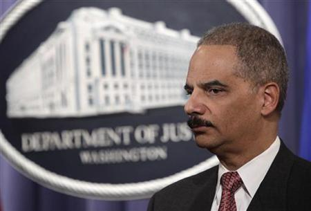 Attorney General Eric Holder pauses during a news conference at the Justice Department in Washington in this February 22, 2010 file photo. REUTERS/Yuri Gripas