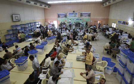 Officials count parliamentary election ballots at a counting centre in Baghdad March 15, 2010. REUTERS/SAAD SHALASH